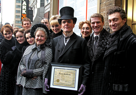 Jefferson Mays shows off his commemorate death certificate after dying 1,000 times in A Gentleman's Guide to Love and Murder.