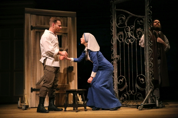Noah Brody as Claudio, Emily Young as Isabella, and Andy Grotelueschen as Duke Vincentio is Fiasco Theater's production of William Shakespeare's Measure for Measure, directed by Noah Brody and Ben Steinfeld, at the New Victory Theater.