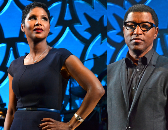 "Toni Braxton and Kenny ""Babyface"" Edmonds strike poses onstage."