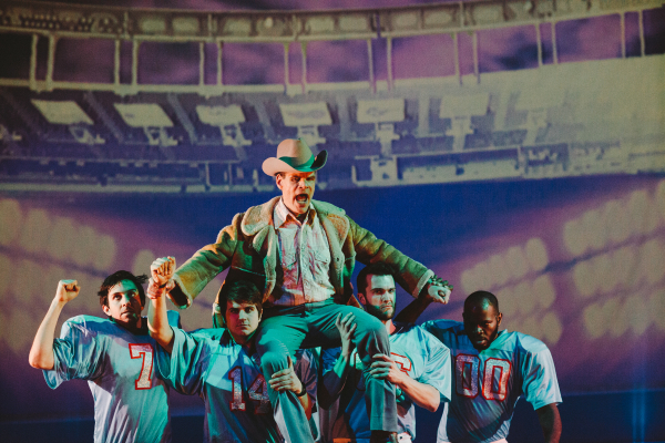 Football coach Bum Phillips (Gary Ramsey) is carried away by his players in Peter Stopschinski's Bum Phillips All-American Opera, directed by Luke Leonard, at La MaMa's Ellen Stewart Theatre.