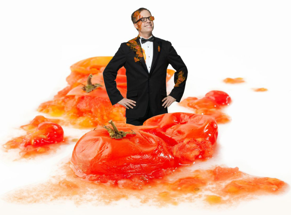 Peter Michael Marino (center, covered in tomatoes) is the writer and star of Desperately Seeking the Exit, a solo show he created about his experiences coauthoring the flop West End musical Desperately Seeking Susan.