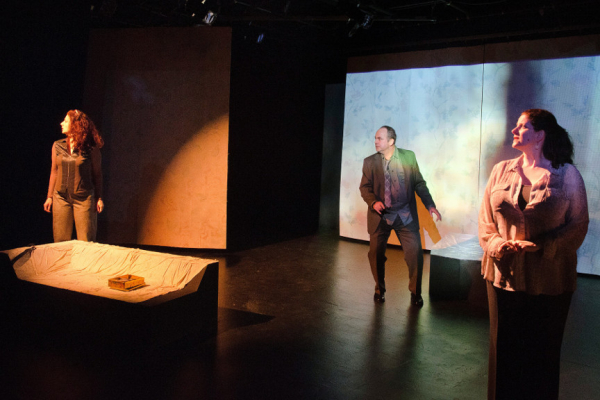 Vera Beren as Leeann, Michael Tomlinson as Remi, and Catherine Porter as Lori in Concrete Temple Theatre's production of Renee Philippi's Alone in Triptych, directed by Eric Nightengale and Renee Philippi, at HERE.
