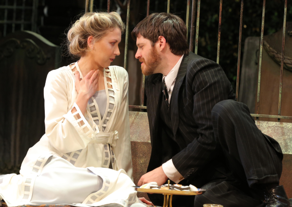 Heléna (Nina Arianda) and Béla (Michael Esper) make out in a graveyard in the Manhattan Theatre Club production of David Grimm's Tales From Red Vienna, directed by Kate Whoriskey, at New York City Center Stage I.