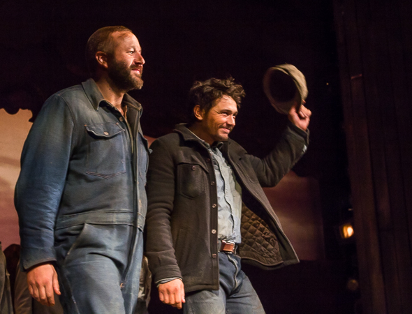 James Franco waves his hat to the audience with costar Chris O'Dowd.
