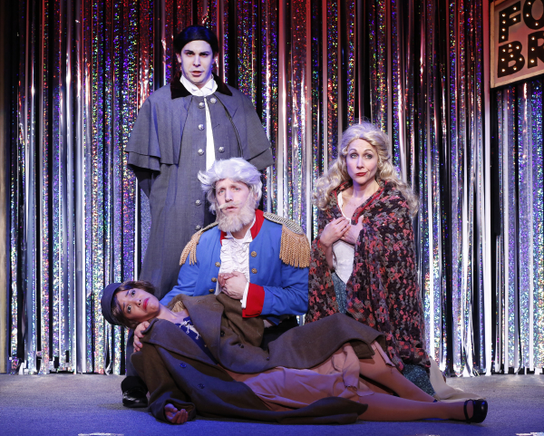 Erica Dorfler (laying down), Scott Richard Foster (kneeling), Marcus Stevens (standing) and Carter Calvert perform a very abridged version of Les Mis in Gerard Alessandrini's Forbidden Broadway Comes Out Swinging!