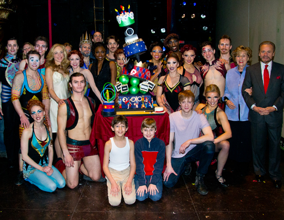 The cast and creative team of Broadway's Pippin poses with a death-defying, multilayer treat.