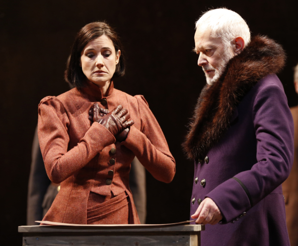 Regan (Bianca Amato) waits with baited breath as her father, The King (Michael Pennington), delineates her third of Britain in William Shakespeare's King Lear, directed by Arin Arbus, at Theatre for a New Audience's Polonsky Shakespeare Center.