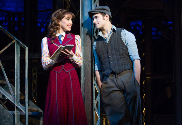 Corey Cott and Liana Hunt as newsboy Jack Kelly and winsome reporter Katherine on the stage of the Nederlander Theatre.