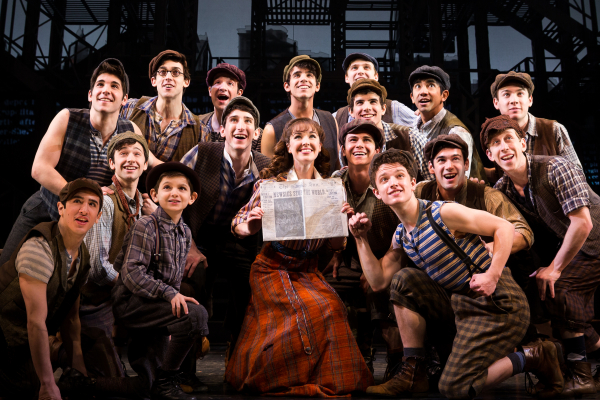 Liana Hunt (center) with the current company of Broadway's Newsies.