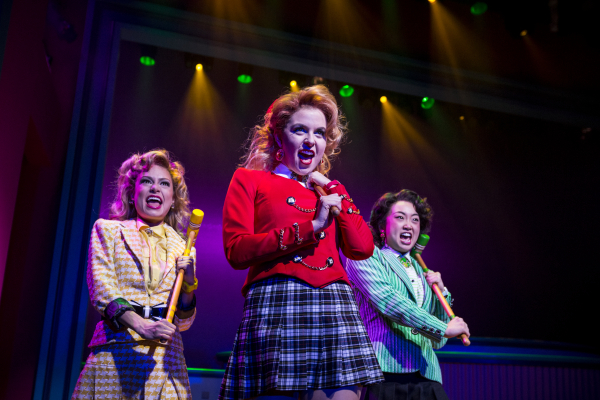 Elle McLemore, Charissa Hogeland, and Alice Lee play croquet mallet-wielding high school tyrants in Laurence O'Keefe and Kevin Murphy's Heathers: The Musical, directed by Andy Fickman, at New World Stages.