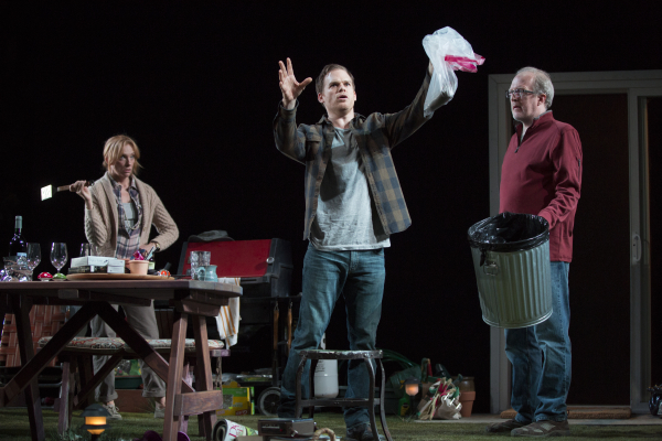Toni Collette, Michael C. Hall, and Tracy Letts dispose of a dead squirrel in Will Eno's The Realistic Joneses, directed by Sam Gold, at Broadway's Lyceum Theatre.