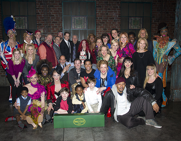 Members of the Kinky Boots family come together for a group photo with their tasty surprise.