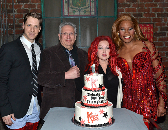 Stars Andy Kelso and Tony winner Billy Porter flank the Kinky Boots authors, Harvey Fierstein and Cyndi Lauper, in front of the anniversary cake.