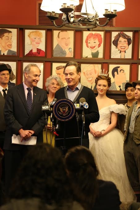 Bryan Cranston, star of Broadway's All the Way, stands beside Senator Schumer as Neil Patrick Harris, Tyne Daly of Mothers and Sons, Kaitlyn Davidson of Cinderella, and Julian DeGuzman and Jess Le Protto of Newsies stand in support of the Broadway tax break.