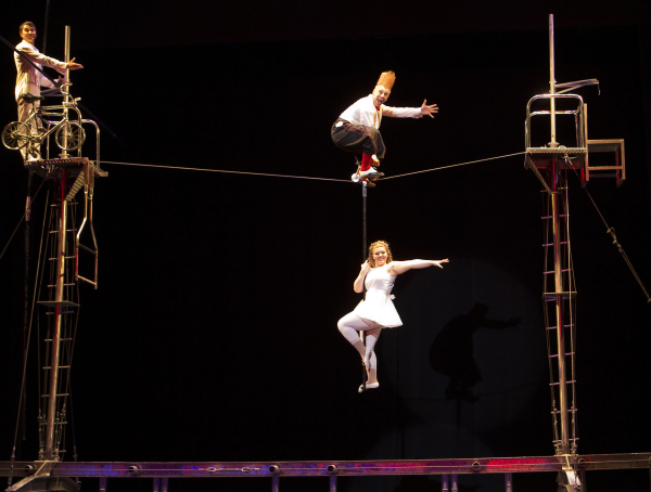 Bello Nock performs on the high wire with Annaliese Nock and Andrew Pratt in Bello Mania, directed by Jennifer Nock, at New Victory Theater.