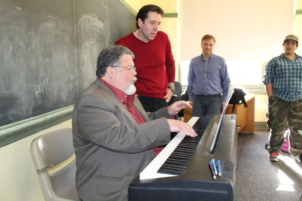 Cabaniss (right) stands beside Herrmann at the piano during a rehearsal for The Homework Machine at Boston Children's Theatre.