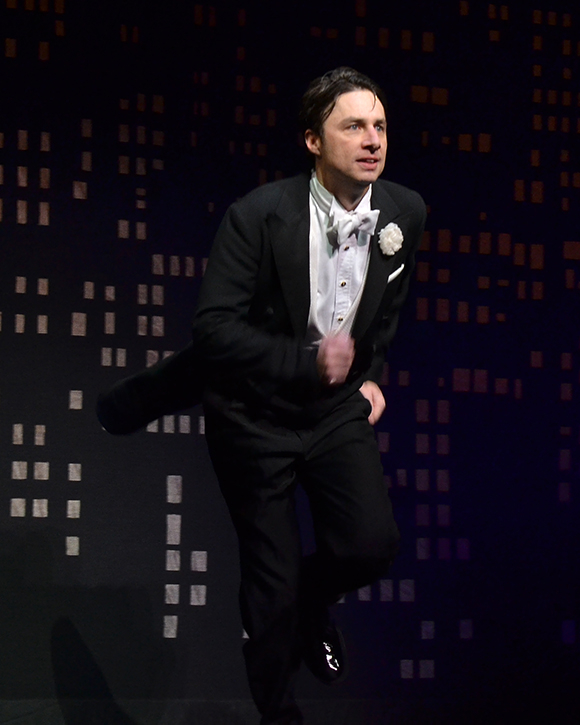 Zach Braff runs out to take his curtain call on the opening night of Bullets Over Broadway at the St. James Theatre.