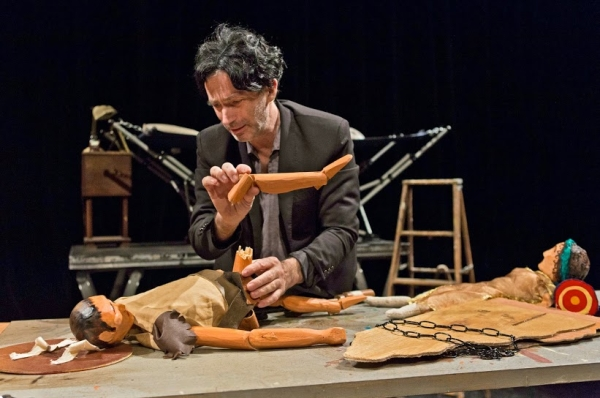 Solo performer Carlo Adinolfi in the world premiere of Extraordinary Extremities, written and directed by Renee Philippi, at SoHo Playhouse.