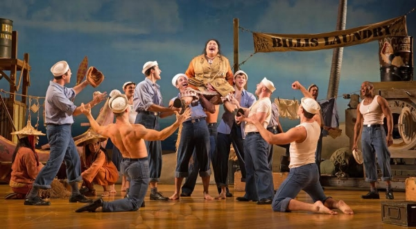 Loretta Ables Sayre as Bloody Mary and the cast of South Pacific, directed by Rob Ruggiero, at Paper Mill Playhouse.