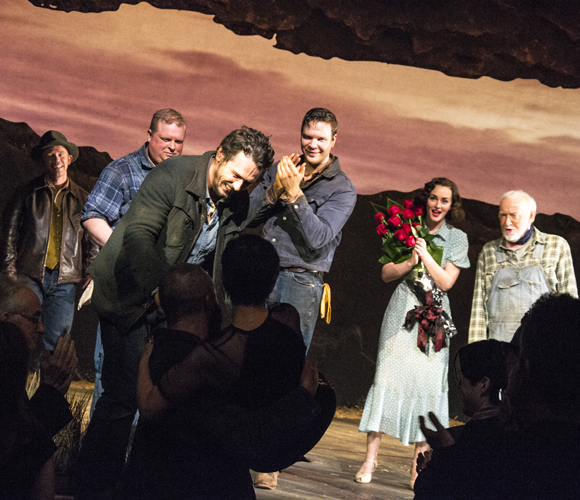As the cast members of Of Mice and Men look on, Chris O'Dowd lifts director Anna D. Shapiro onto the stage with the assistance of James Franco.