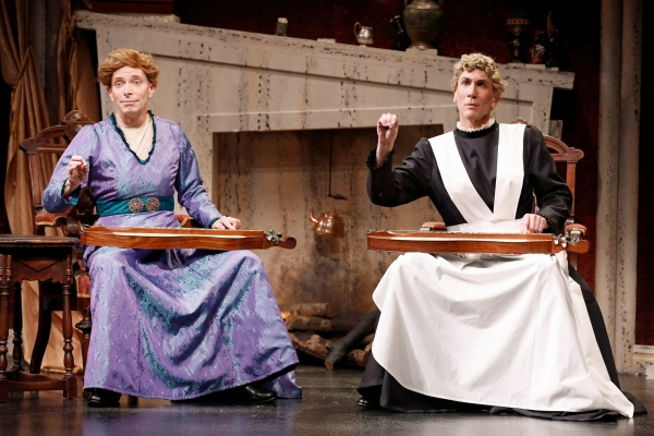 Arnie Burton and Robert Sella play a dulcimer duet in the Charles Ludlam's The Mystery of Irma Vep, directed by Everett Quinton, at the Lucille Lortel Theatre.