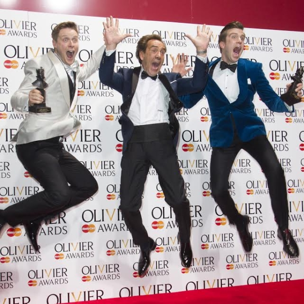 Stephen Ashfield, Robert Lindsay, and Gavin Creel celebrate at the WhatsOnStage Awards.
