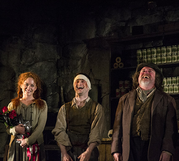 Sarah Greene, Daniel Radcliffe, and Pat Shortt are thrilled by the audience's reaction as they take their bow.
