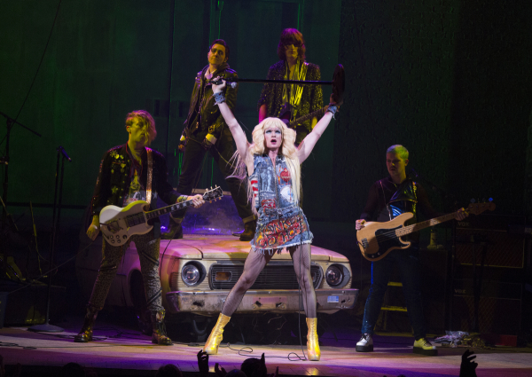 Hedwig (Neil Patrick Harris) is backed up by her band, the Angry Inch: Krzyzhtoff (Tim Mislock), Yitzhak (Lena Hall), Skszp (Justin Craig), and Jacek (Matt Duncan) in John Cameron Mitchell and Stephen Trask's Hedwig and the Angry Inch, directed by Michael Mayer, at the Belasco Theatre.