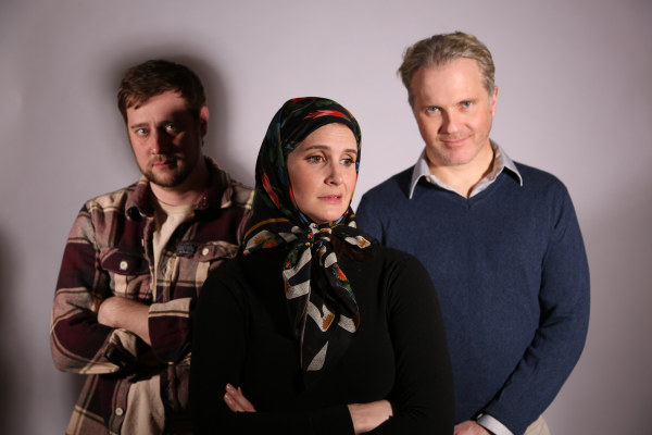 Ted Schneider as Dave, Carey Van Driest as Irene, and Timothy Carter as Hans in Origin Theatre Company's production of Tim Ruddy's The International, directed by Christopher Randolph, at The Cell.