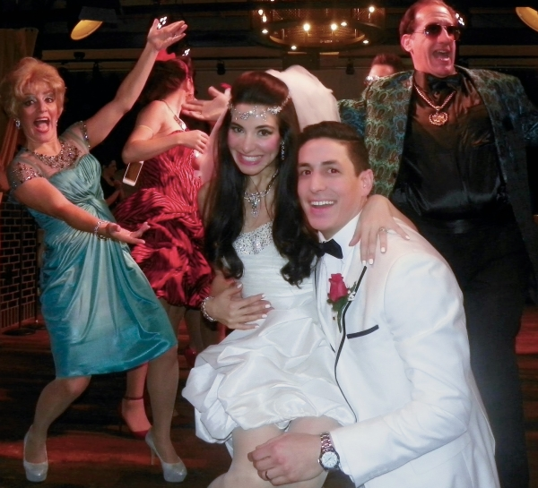 Cast members Susan Campanaro, Marilia Angeline, Joe Ferraro, and Al Quagliata in Tony n' Tina's Wedding, directed by Tony Lauria, at Jacqueline Onassis High School and Guy's American Kitchen and Bar.
