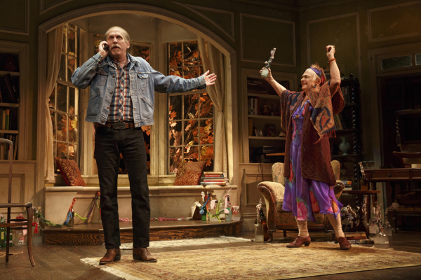 Chris (Stephen Spinella) argues with his siblings while his mother, Alexandra (Estelle Parsons), precariously waves a Molotov cocktail in the air in The Velocity of Autumn.