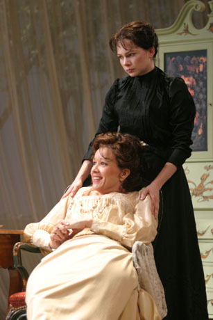 Michelle Williams (standing) as Varya and Linda Emond (seated) as Madame Ranevskaya in Michael Greif's 2004 production of The Cherry Orchard at Williamstown Theatre Festival.