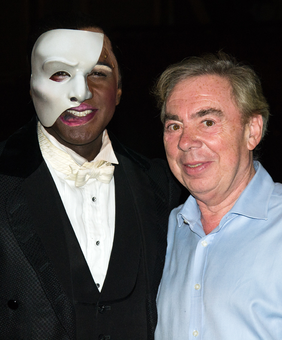 Norm Lewis poses for photos with Andrew Lloyd Webber just moments after making his debut in the title role of Broadway's The Phantom of the Opera.