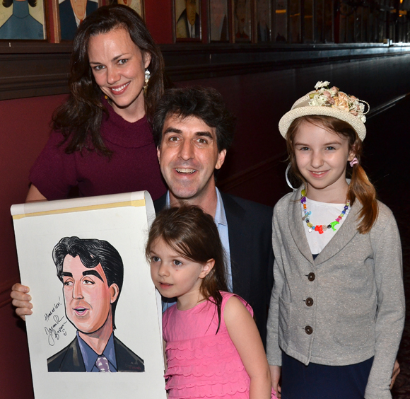 Jason Robert Brown poses with his new Sardi's caricature and his family, wife Georgia Stitt and their daughters, Susannah and Molly.