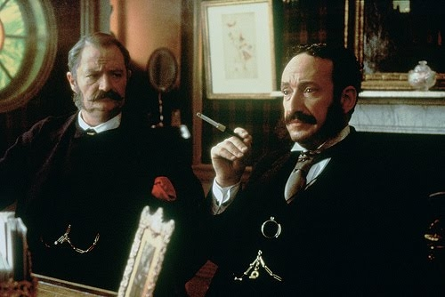 Jim Broadbent (l) as W.S. Gilbert and Allan Corduner as Sir Arthur Sullivan in the 1999 film Topsy-Turvy.