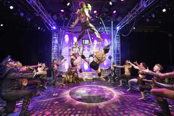 Aerialists rotate on a giant anarchy symbol in the finale of The Anthem, directed by Rachel Klein, at Culture Project's Lynn Redgrave Theater.
