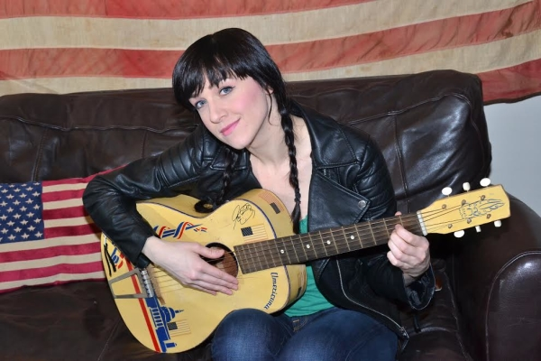 Lena Hall strums her guitar in the Belasco dressing room where she goes from punky rocker princess to moody rocker prince.