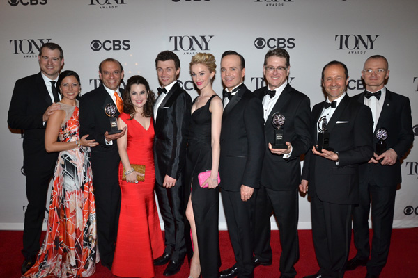 Members of the cast and production team behind 2014 Tony winner for Best Musical A Gentleman's Guide to Love and Murder pose with their awards.