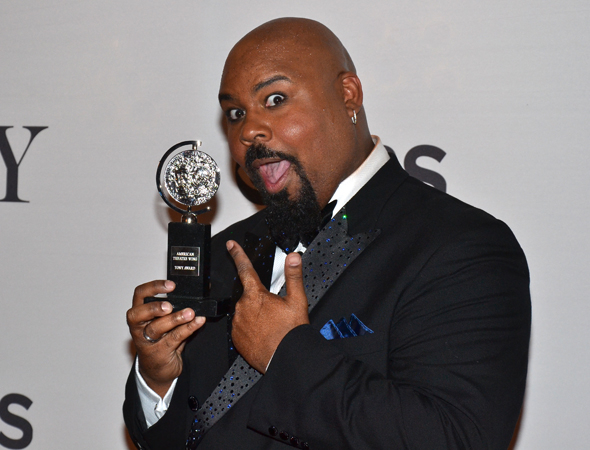 James Monroe Iglehart stops for photos on his way to McDonald's.