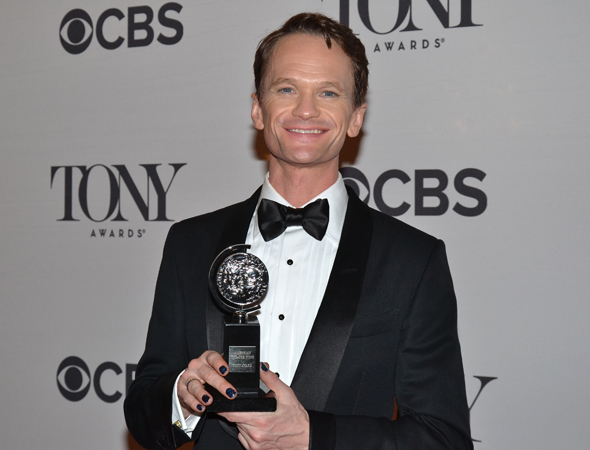 Neil Patrick Harris smiles slyly while showing off his Tony.