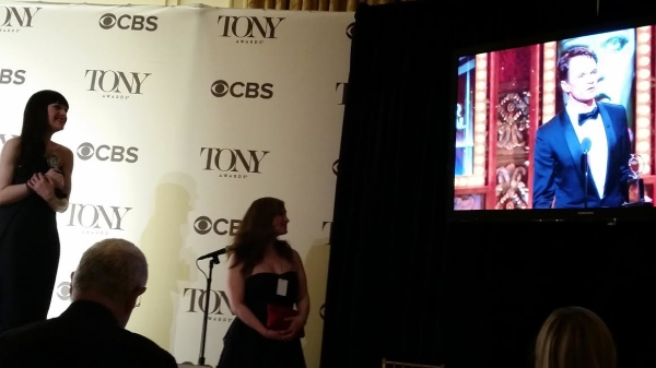 Lena Hall watches as Hedwig costar Neil Patrick Harris gives his Tony acceptance speech.