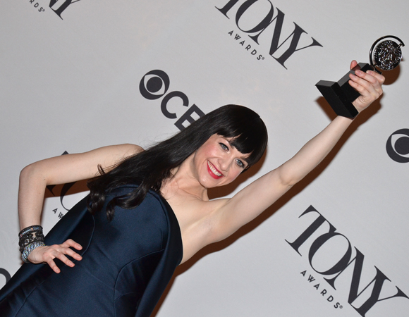 Lena Hall shows off her Tony Award in the press room.