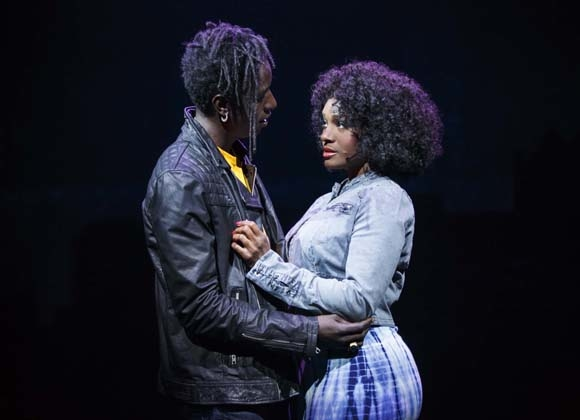 Saul Williams and Saycon Sengbloh share a tender moment as John and Corinne in Broadway's Holler If Ya Hear Me, which will end performances at the Palace Theatre on TKTK.