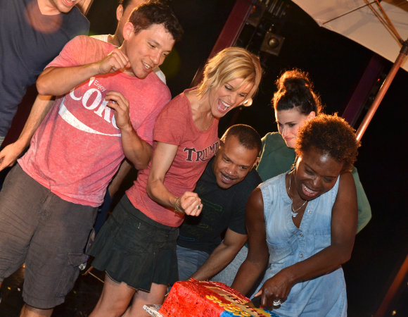 LaChanze cuts the cake as Miguel Cervantes, Jenn Colella, and Idina Menzel look on.