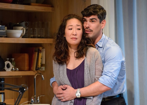 Sandra Oh as Paulina Salas and Raúl Castillo as her husband, Gerardo, in Ariel Dorfman's Death and the Maiden, directed by Chay Yew at Chicago's Victory Gardens Theater.