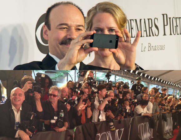 Danny Burstein takes a photo of the red carpet at the 2014 Tony Awards as his wife, Rebecca Luker, looks on.