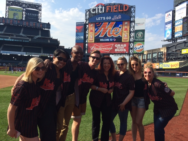 Lauren Chapman, Robert Pendilla, Kevin Smith Kirkwood, Stephen Carrasco, Jen Perry, Abby Mueller, Anna Eilinsfeld, and Adinah Alexander prepare to perform on Citi Field.
