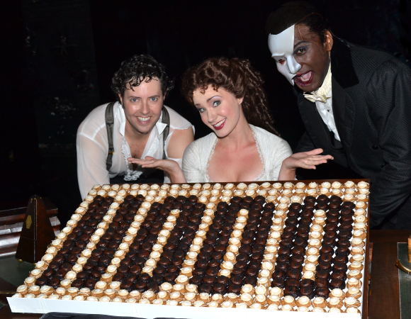 Greg Mills (Raoul), Sierra Boggess (Christine), and Norm Lewis (The Phantom) check out their celebratory cupcakes.