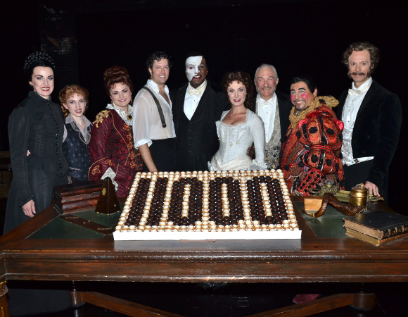 Phantom cast members Cristin J. Hubbard (Madame Giry), Polly Baird (Meg Giry), Michele McConnell (Carlotta), Greg Mills (Raoul), Norm Lewis (The Phantom), Sierra Boggess (Christine), Tim Jerome (Monsieur Firmin), Christian Šebek (Piangi), and Laird Mackintosh (Monsieur André) celebrate their show's landmark performance.