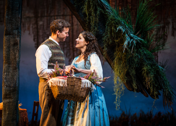 Kevin Earley as Tommy Albright and Jennie Sophia as Fiona MacLaren in Lerner and Loewe's Brigadoon, directed by Rachel Rockwell, at the Goodman Theatre.